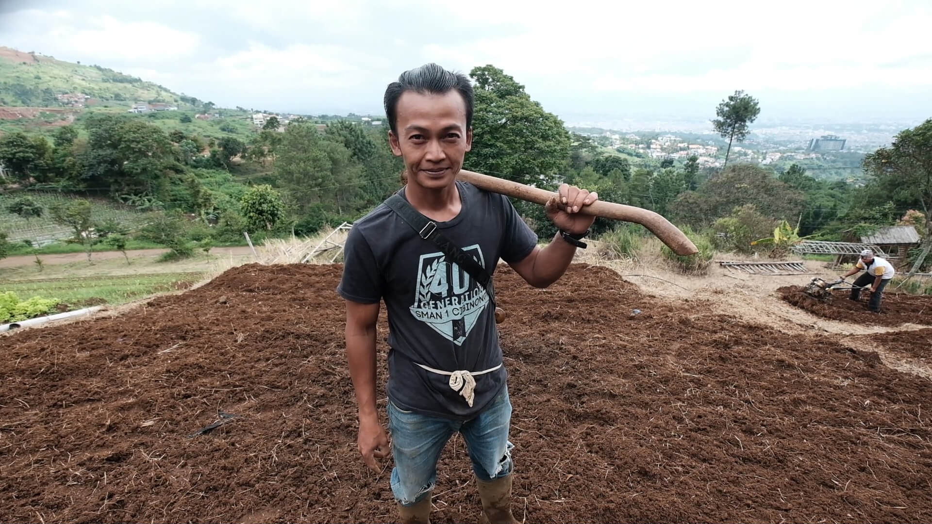 Farmer Tisna Rohmat, 33, strikes a pose in his vegetable farm in Ciburial, West Java - The Jakarta Post
