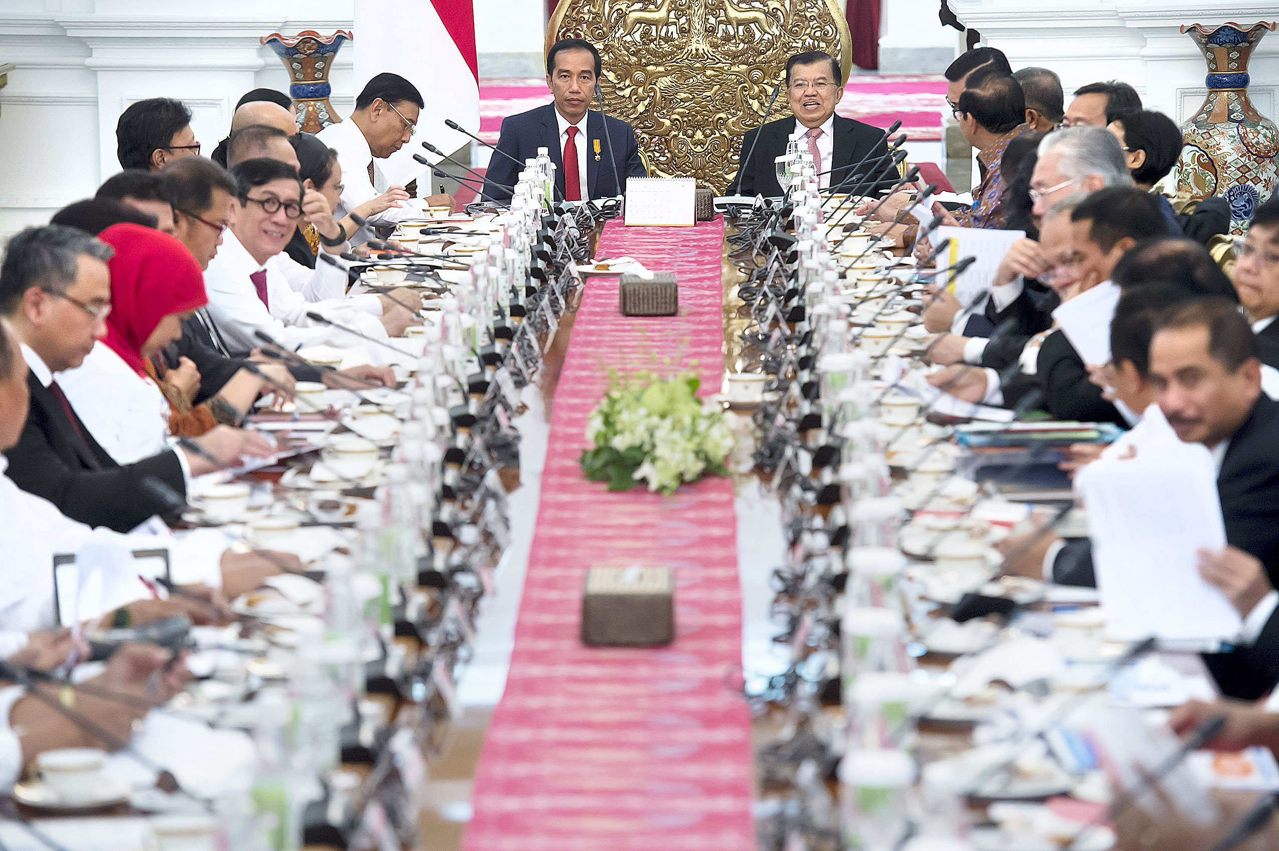 "Getting down to business: President Joko ""Jokowi"" Widodo (top left) and Vice President Jusuf Kalla (top right) chair a plenary Cabinet meeting with the new members of the newly-formed Cabinet."