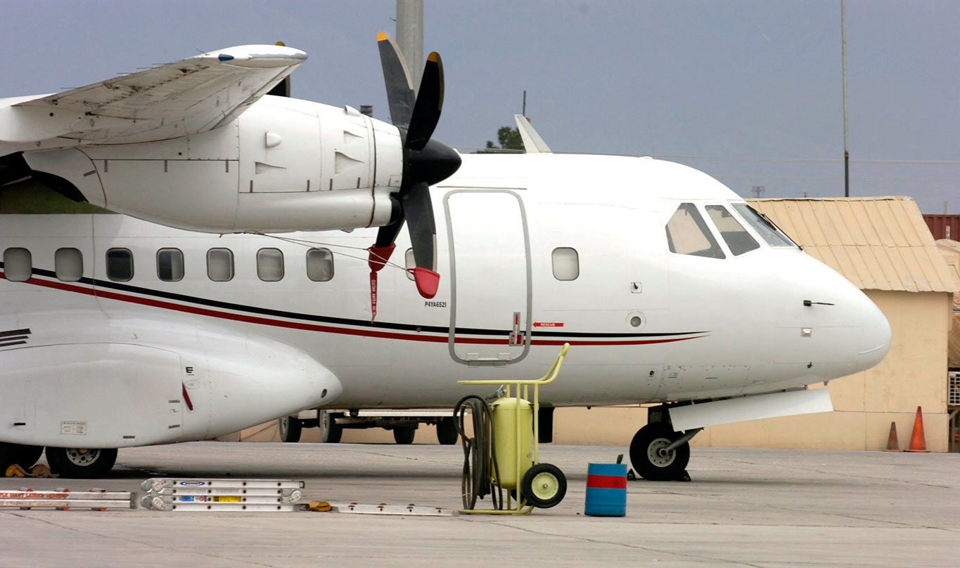 A Presidential Airways Casa CN-235-10 with 53rd Movement Control Battalion (Echelons Above Corps) is parked on the flight line on Dover Air Force Base, Del., March 30, 2009, as it receives maintenance. The aircraft is used to move passengers, palettes and mail. It can carry twice as much as the Casa C-212 Aviocar aircraft and requires three crew members on all missions. (U.S. Army photo by Pvt. Cody A. Thompson)